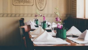 Dinner tables with fresh flowers and folded napkin at Ledbury Restaurant